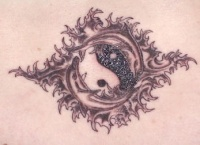 Yin yang tattoo with dolphins and patterns