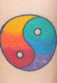 yin yang tattoo with rainbow colors